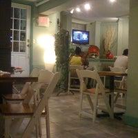 Photo taken at Ivy Cafe by Ajit V. on 8/3/2011