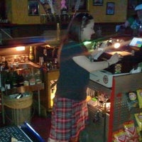 Photo taken at Cigars & Stripes BBQ Lounge by Dale G. on 3/18/2012
