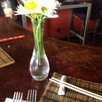Photo taken at Coconut Thai Cuisine & Asian Fusion Restaurant by Sarah R. on 8/21/2012