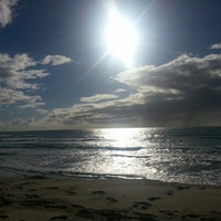 Photo taken at Nobby Beach by Lyndall P. on 5/8/2013