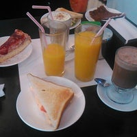 Photo taken at Cafe De La Avenida by David C. on 9/24/2014