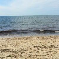 Photo taken at Sea Street Beach by Lloyd M. on 7/29/2013
