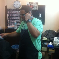 Photo taken at Nelson's Barbershop by C B. on 12/18/2012