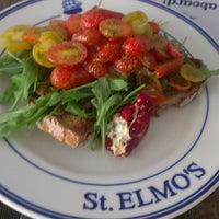 Photo taken at St. Elmo's  Seaside Brasserie by Michele L. on 4/26/2013