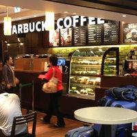 Photo taken at Starbucks Coffee 関西国際空港エアサイド店 by BACKY ば. on 1/6/2013