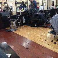 Photo taken at Denny Moe's Superstar Barbershop by Askia B. on 1/12/2013