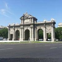 Photo taken at Alcalá Gate by Patricia G. on 6/27/2013