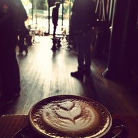 Photo taken at Stumptown Coffee Roasters by khonkaender k. on 5/31/2013