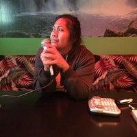 Photo taken at Karaoke Hut Sports Bar & Grill by Kaonohi B. on 3/8/2014