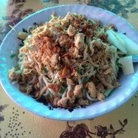 Photo taken at Depot Mie Pangsit Tenda Biru by Faskho N. on 8/15/2014