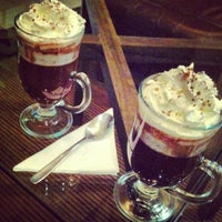 Photo taken at Urbe Café Bar by Herminio A. on 6/27/2013