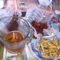 Photo taken at Wingstop by Aleidi D. on 12/27/2014