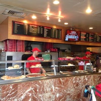 Photo taken at Famous Famiglia Pizza by Lane R. on 4/19/2015