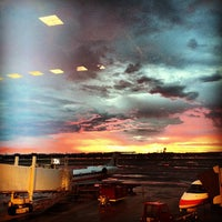 Photo taken at Gate 32 by Angie P. on 7/8/2013