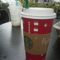 Photo taken at Starbucks by Gio O. on 12/29/2012