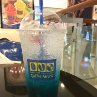 Photo taken at Coffee World by Champ S. on 4/7/2016