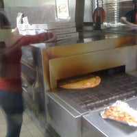 Photo taken at Filippo's Pizzeria by Andre H. on 12/8/2011