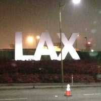 Photo taken at LAX Sign by Rafael C. on 4/4/2013
