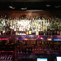 Photo taken at The Aero Club Bar by Ashley S. on 12/28/2012