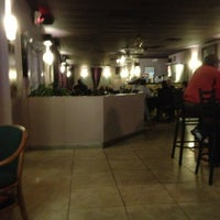 Photo taken at Cuba Cafe Restaurant by Douglas S. on 2/6/2013