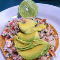 Photo taken at 8 Tostadas by CARLOS G. on 4/14/2013