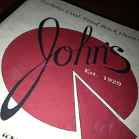 Photo taken at John's Pizzeria by Ashley B. on 12/28/2012