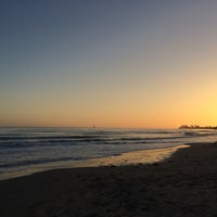 Photo taken at Isla Vista Beach by Mark V. on 4/14/2014