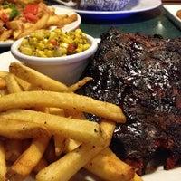 Photo taken at Smokey Bones Bar & Fire Grill by Elle J. on 4/13/2014