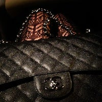 Photo taken at CHANEL Boutique by Nina Z. on 1/12/2013