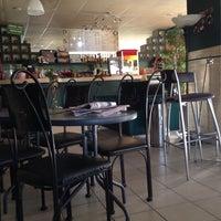 Photo taken at 5ta. Avenida Café by Saul S. on 10/5/2014