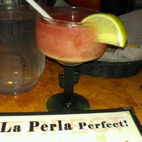 Photo taken at La Perla by Megan L. on 2/17/2013