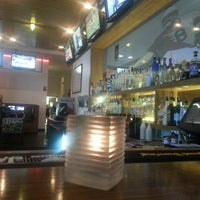 Photo taken at The Over/Under Bar & Grill by Jerry T. on 4/4/2013