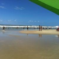 Photo taken at Praia de Imbé by Marcelo S. on 1/12/2013