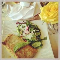 Photo taken at La Frite Cafe by Lana on 4/7/2013