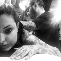 Photo taken at Eskimo Tattoo by Siane I. on 3/29/2014