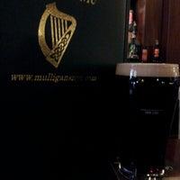 Photo taken at Mulligan's Pub by Stephen G. on 4/4/2013