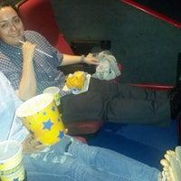 Photo taken at Super Cines 8 by Iris R. on 9/30/2014