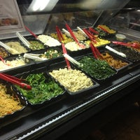 Photo taken at NuVegan Café by Daniel K. on 12/5/2012