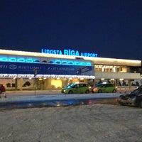 Photo taken at Riga International Airport (RIX) by Alina K. on 1/12/2013