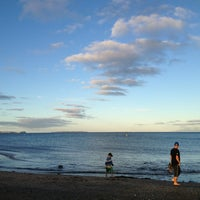 Photo taken at Long Bay Beach by takuma y. on 2/17/2013