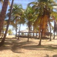 Photo taken at Playa de Boca de Uchire by Aracelis M. on 8/24/2014