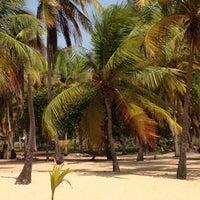 Photo taken at Playa de Boca de Uchire by Aracelis M. on 3/23/2014