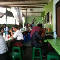 Photo taken at Warung Pokwe Bu Trini by Ngalim Z. on 3/9/2013