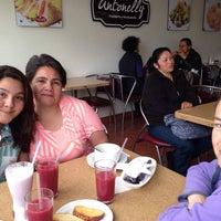 Photo taken at Tomaselly by Jennifer C. on 12/14/2013
