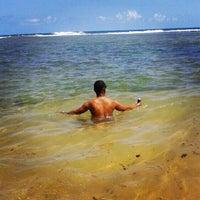 Photo taken at Praia do Pirui by Dan Danival D. on 12/30/2013