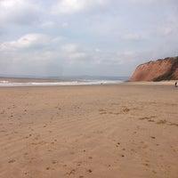 Photo taken at Sandy Bay Beach by Jennifer J. on 4/6/2013