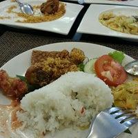 Photo taken at Goela Klapa Restaurant by Zain A. on 11/10/2013