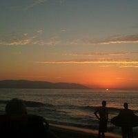 Photo taken at Playa de los Muertos by Roger C. on 2/4/2013