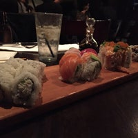 Photo taken at Okura Robata Sushi Bar and Grill by Cj T. on 10/5/2015