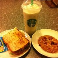 Photo taken at Starbucks by Mei L. on 4/25/2013